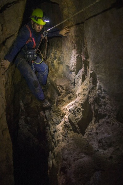 Mine explorer using ropes to traverse stoping in a Cornish tin mine.