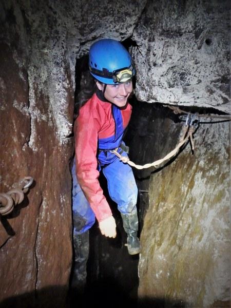 Mine explorer traverses a flooded passage in a Cornish tin mine.