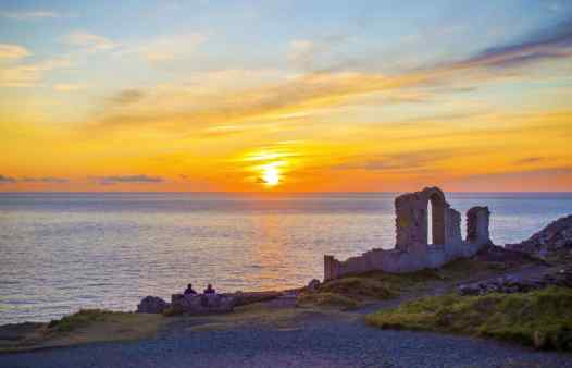 Sun sets  on the mine ruins at Botallack, St. Just Cornwall. Cornwall's best site for exploring the surface mine features.