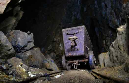 An abandoned mine cart in a Cornish tin mine. Step into the boots of the Cornish miners on an underground adventure. The ultimate day out in Cornwall, Newquay, St. Ives or Penzance.