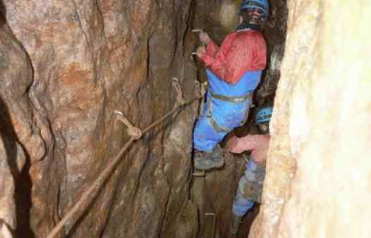 Using a traverse line to cross a deep, narrow stope on a Cornish tin mine.